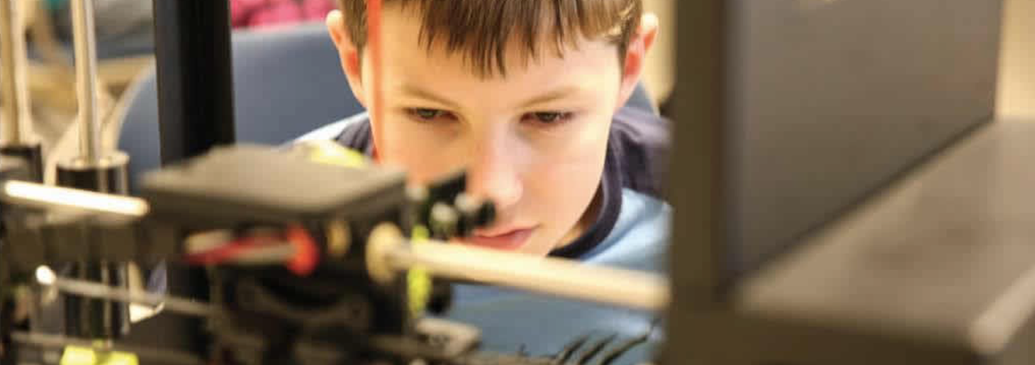 Image: VA Space Flight Academy - boy watching his CAD creation being made on 3D printer